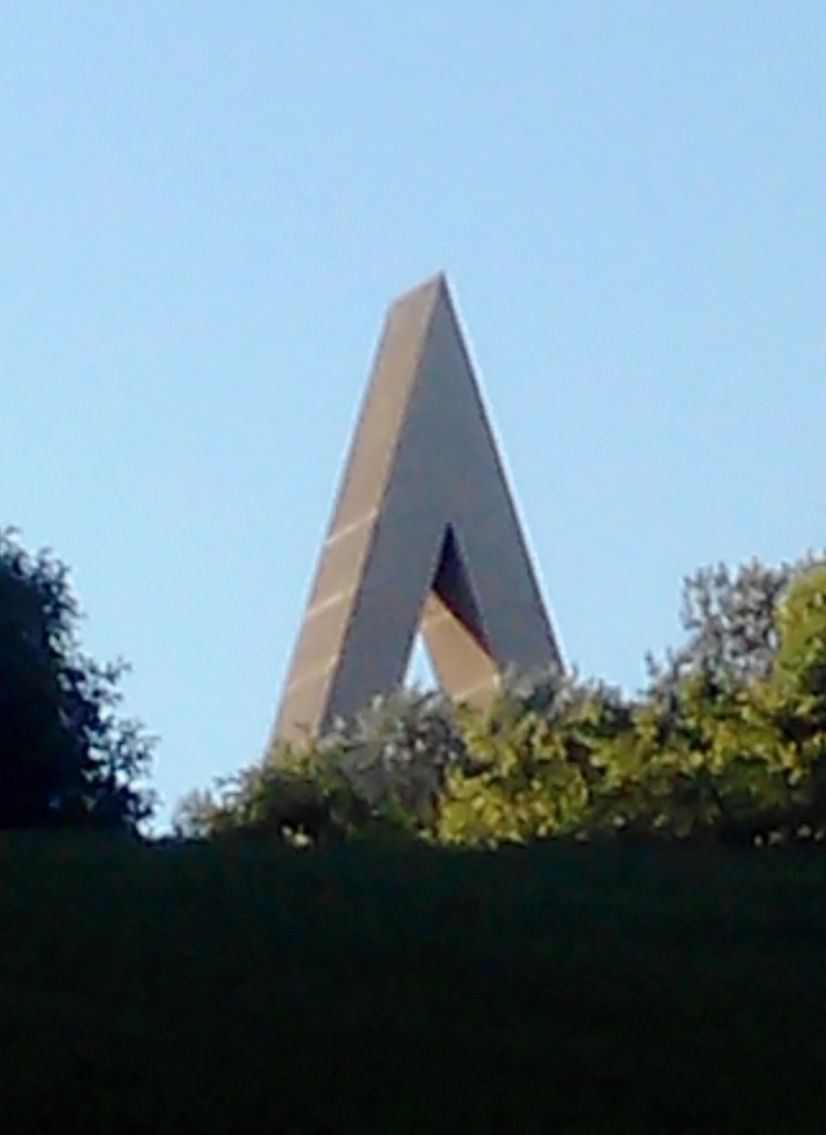 Sited on the crown of the hill to emphasise its height, the capital letter A is the first hint you have that a Brossa work inhabits the vicinity