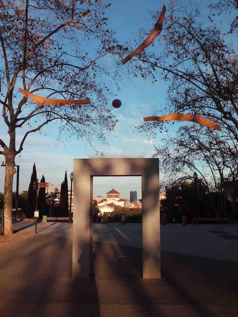 Looking through Silvia Gubern's installation Feníxia, over Barcelona's Teatre Lliure and Hotel Arts